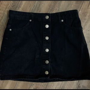 A cute black denim skirt with buttons up the front